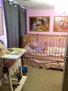 Adult Baby Rachel in cot
