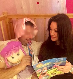 Nanny Betty reading to adult baby Amy